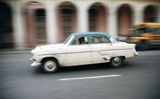 Old American sedan driving through Havana,Cuba
